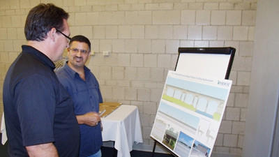 Michigan Department of Transportation bridge project design engineer Raja Jildeh (right) discusses planned updates for the Mitchell Street Bridge with Petoskey Regional Chamber of Commerce president Carlin Smith during an informational meeting Monday.