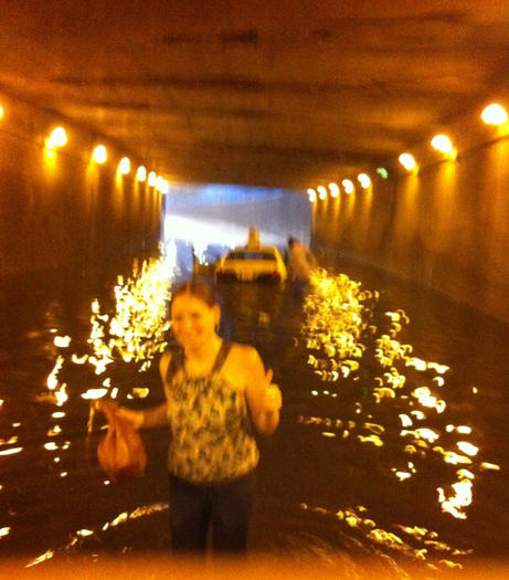 Shannon Condon, 26, of Lakeview gives a thumbs-up for their cab-flooding, water-wading adventure.