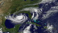 Isaac reached hurricane status Tuesday as it closed it on the Gulf Coast, threatening to deluge parts of the region with huge amounts of rain.