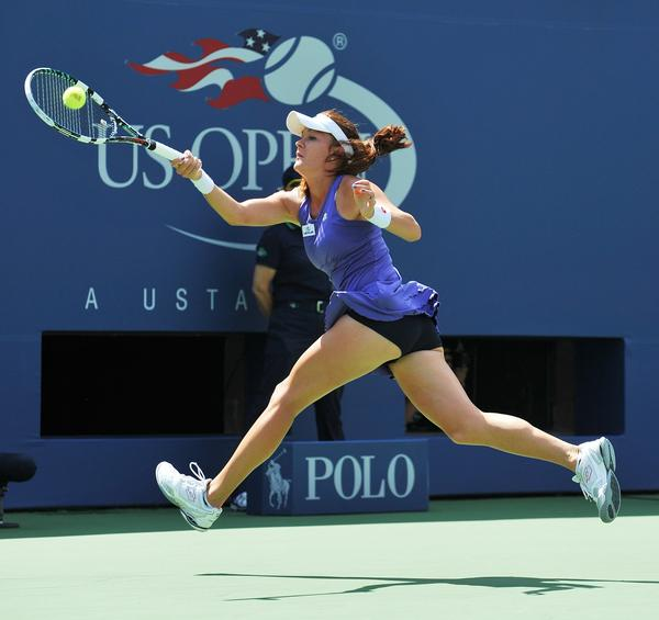 Agnieszka Radwanska hits a return to Nina Bratchikova during their match on the second day of the U.S. Open.
