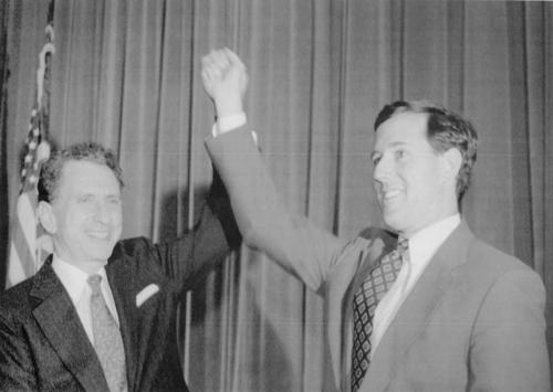 Pennsylvania Republican Senator Arlen Spector, left, holds up the hand of Republican senatorial candidate Rep. Rick Santorum in Philadelphia Monday, Oct. 3, 1994. Specter was one of several U.S. Senators attending a fundraiser to endorse Santorum for Pennsylvania's other Senate seat.