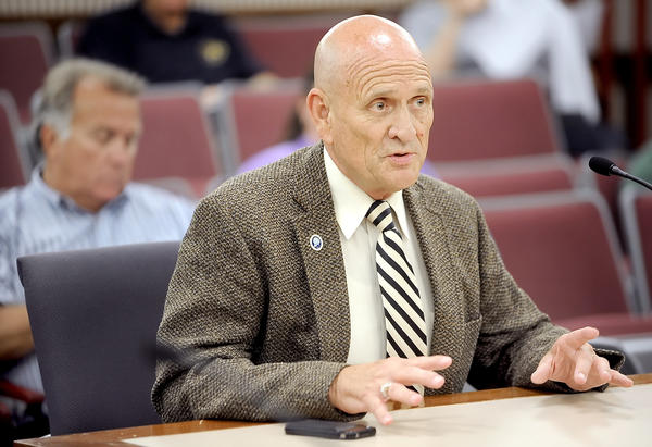 Hagerstown-Washington County Economic Development Commission member Ron Bowers asks the Washington County Board of Commissioners Tuesday to eliminate all excise taxes to help stimulate economic growth.
