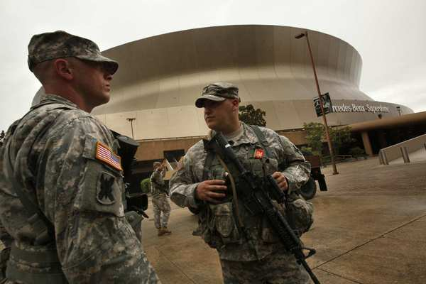 Members of the National Guard patrol near the New Orleans Superdome as Hurricane Isaac approaches.