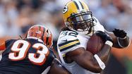 GREEN BAY, Wis. — So here is Cedric Benson, staying late at Lambeau Field after most of his teammates have left to review more tape.