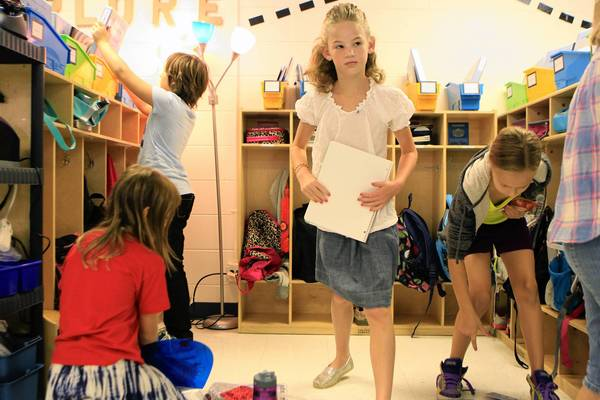 Fourth graders including Eleah Gersten , 9, center, prepare to start school recently at Grove Avenue School in Barrington. Across the U.S., parents are dealing mature clothing designs for younger girls.