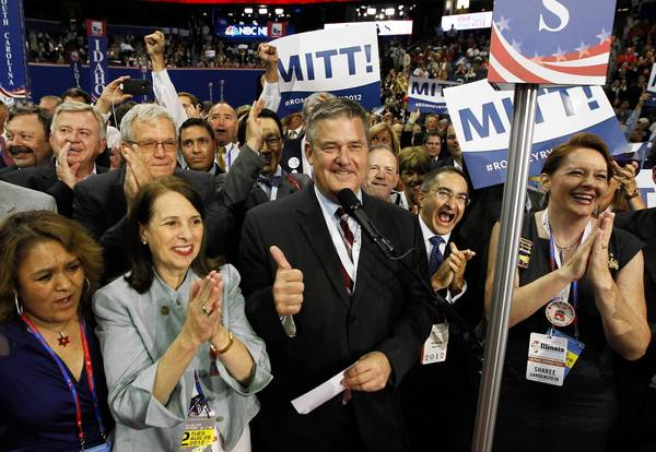 Illinois Treasurer Dan Rutherford, center, celebrates with his delegation after casting their votes for Gov. Mitt Romney during the roll call Tuesday at the Republican National Convention in Tampa, Fla.