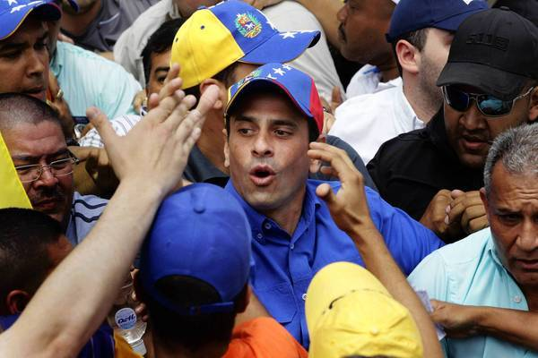 Opposition presidential candidate Henrique Capriles greets supporters at a campaign rally in Caracas, Venezuela.