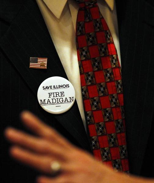 "Illinois GOP chairman Pat Brady wears a ""Fire Madigan"" button during the delegation breakfast Monday at the Sheraton Sand Key Resort in Clearwater Beach, Fla. before the start of the Republican National Convention."