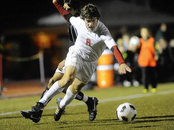 Parkland's Collin McConnell (6), front, tries to dribble past Emmaus' Mark Graefe (15), back, in the first half of the District 11 3A boys soccer semifinal game held at Whitehall High School on Tuesday, November 1, 2011.
