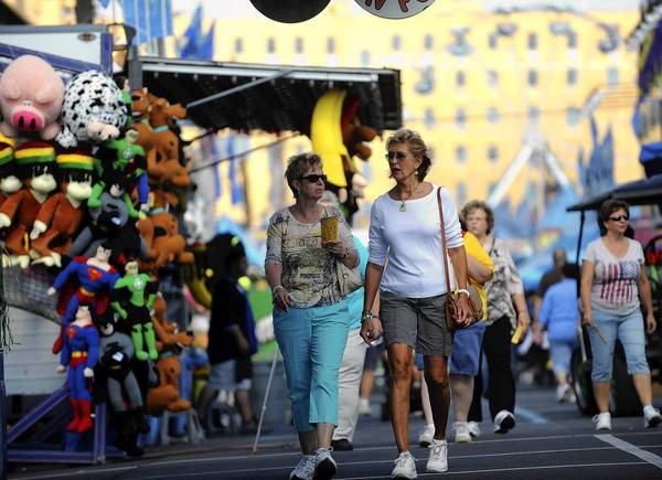 Pat Meleski of Allentown, left, and Rosemarie Shadle of South Whitehall Township walk the midway moments after the Allentown Fair opened on Tuesday afternoon.