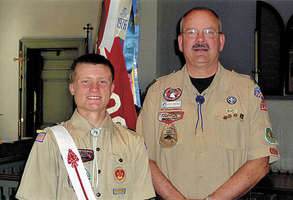 Eagle Scout Breese Morse Dickinson IV, left, is shown with T. Hunt Hardinge, troop leader of Boy Scout Troop 10. The troop is sponsored by Trinity Lutheran Church in Hagerstown.