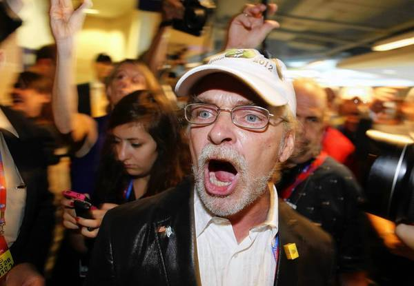 Maine delegate and Ron Paul supporter Pete Harring shouts as he walks out of the hall in disgust over not being seated at the Republican National Convention in Tampa, Fla.