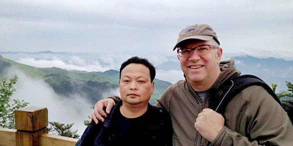 """Bigfoot"" director Ethan Wiley with Shennongjia Nature Reserve Official."