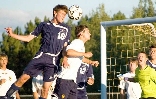 Petoskey senior Louis Lamberti heads the ball toward the net Tuesday in a 6-1 Big North Conference victory over Gaylord. Lamberti scored two goals to lead Petoskey.