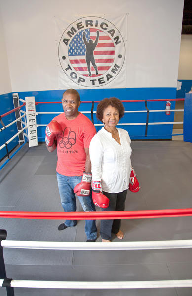 "Olympic boxer Howard Davis Jr., left, with outstanding volunteer Mattie Brown. Brown, 65, volunteers for the Broward County VA Clinic in Sunrise. ""I want to help anyway I can; my life isn't perfect, I have suffered losses but I can still give back and inspire,"" said Brown."