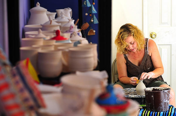 Paula Bailey creates a pot at The Little Pottery House, which she opened in May at 203 S. Princess St. in Shepherdstown, W.Va.
