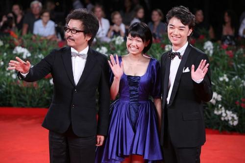 "Director Sono Sion, actor Shota Sometan, and actress Fumi Nikaido arrive on the red carpet for the premiere of ""Himizu."""