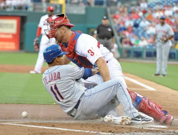 New York Mets shortstop Ruben Tejada (11) slides safely into home as Philadelphia Phillies catcher Erik Kratz (31) can't hang onto the throw in the first inning at Citizens Bank Park.