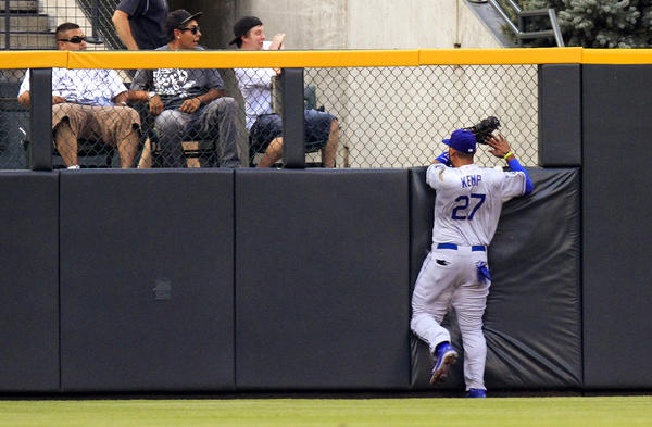 Matt Kemp slams into the wall Tuesday.
