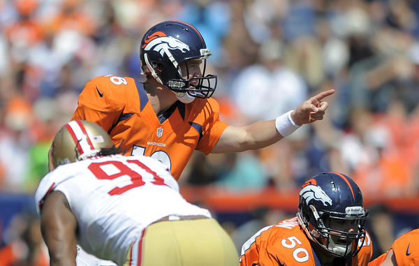Denver Broncos quarterback Peyton Manning calls a play during the first quarter of an NFL preseason game Sunday.