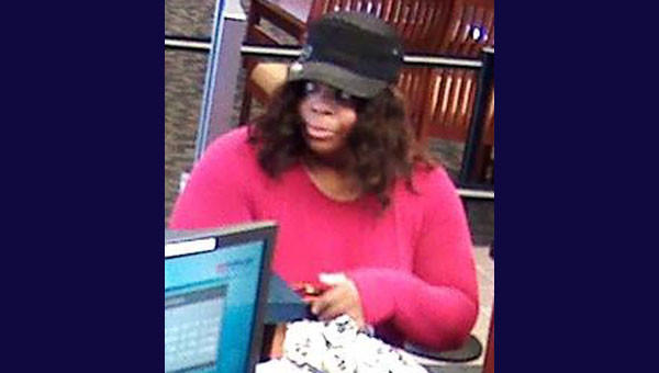 Surveillance photo of a woman who robbed a Northwest Side bank on Tuesday.