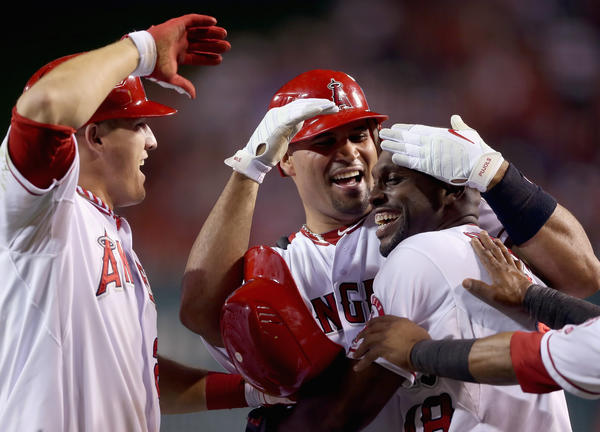 Mike Trout, Albert Pujols and Torii Hunter celebrate a win over Boston.