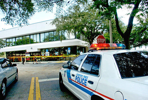 "The FBI and Pembroke Pines Police investigate the holdup Wednesday of a BankAtlantic branch. The bank, at 11200 Pines Blvd. near South Hiatus Road, was robbed around 9:37 a.m. Pembroke Pines Police Officer Alex De La Paz said the FBI was on the scene and would lead the investigation.  ""The robber walked in, demanded money and exited the bank on foot, to the west,"" De La Paz said. ""There are no reports of injuries at this time."""