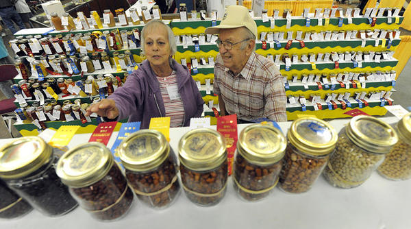 Carolyn Rosko of Allentown a volunteer at the fair (left) helps Stanley H. Wohlbach 92, of Hellertown locate his canned dry goods during the Great Allentown Fair Wednesday afternoon.