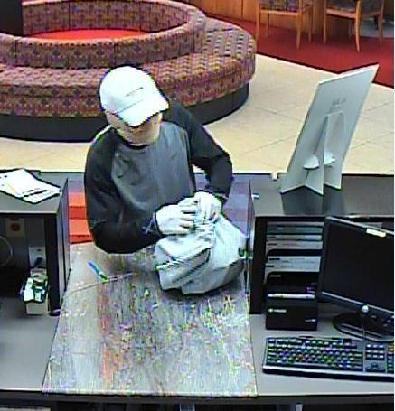The FBI is searching for the masked man who robbed a BankAtlantic branch in Deerfield Beach