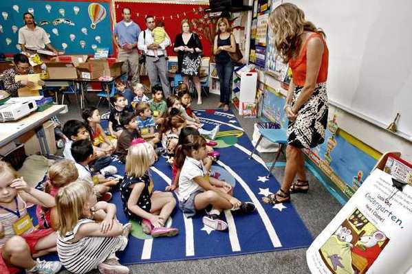 With some anxious parents looking on, La Canada Elementary School kindergarten teacher Becca McLarty, right, greets her class of 22 students during the first day of class on Tuesday, August 28, 2012.