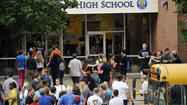 Perry Hall High School will maintain a heightened police presence until its principal determines that the campus is ready to return to normal, in the aftermath of a cafeteria shooting in which one student critically injured another on the first day of school.
