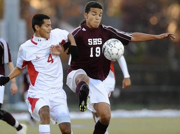 Stroudsburg's Jordon Ellison (19), right, battles for a loose ball with Pocono Mountain East's Martin Dieppa (4) left, in the first half during the District 11 3A boys soccer semifinal game held at Whitehall High School on November 1, 2011.
