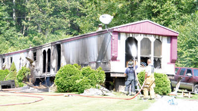 An electrical fire ripped through a mobile home Wednesday leaving a family of four homeless.