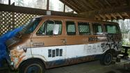 A van decorated by famous Seattle rocker Kurt Cobain sold on eBay Tuesday for a sprightly $24,701.
