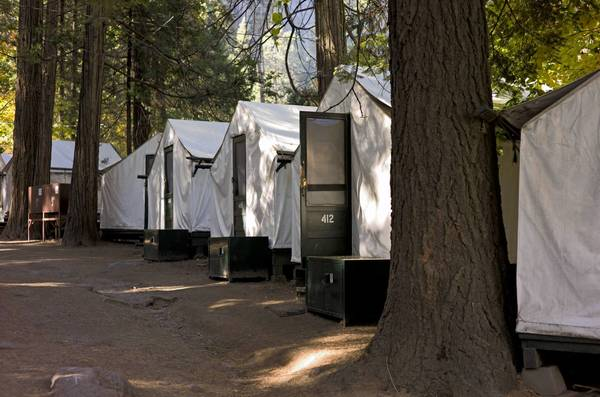 Signature tent cabins at Curry Village in Yosemite National Park have been closed as crews clean the structures and tear out wooden interior walls, where they have found deer mouse droppings and nests in the insulation, a park spokeswoman said. Guests have been relocated to other areas of the park.