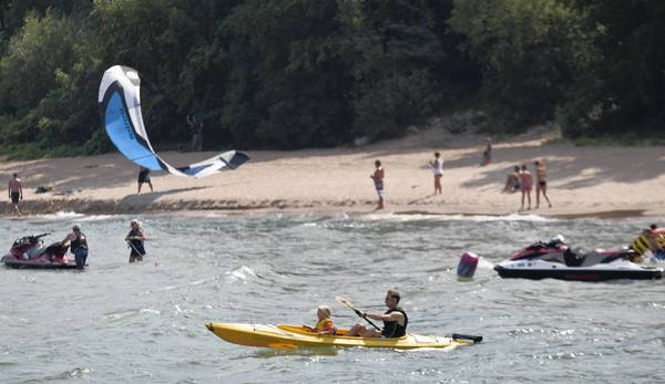 Beachgoers enjoy a warm day at Lloyd Beach in Winnetka. The North Shore village's park district operates three swim beaches, one boat launch/sailing center and a dog beach.