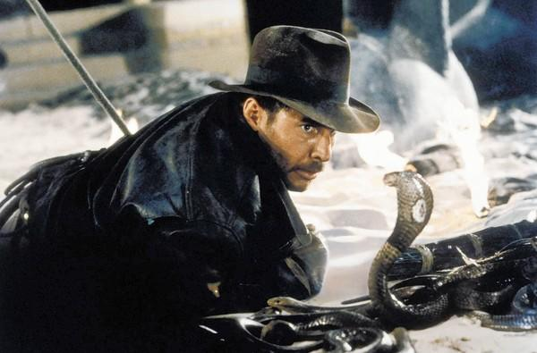 "Harrison Ford comes face-to-face with a cobra in a scene from ""Raiders of the Lost Ark."""