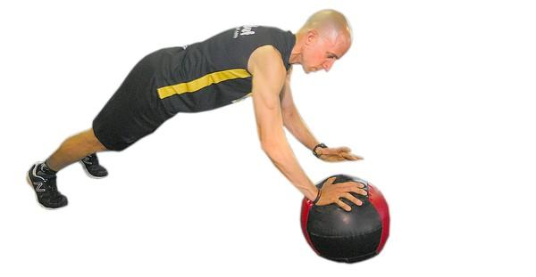 Place your hands shoulder-width apart with your left palm on the ground and your right palm on the medicine ball. Your hands are now in a staggered position, and you have to steady your body. Then, perform a push-up. When you come back up and fully extend your elbows, you will then bring your left hand onto the medicine ball and move your right hand onto the ground, arms extended at this time.