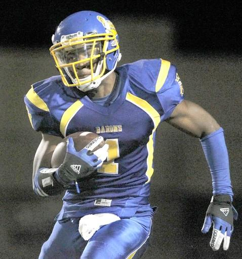 [Fountain Valley High's Shavony Drew carries the ball against Foothill during Friday's game.