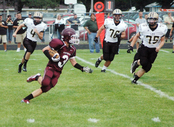 Charlevoixs Charlie Hamilton (3) turns and looks downfield after catching a pass in the last minute of the first half of the Rayders' season opener last Friday against St. Ignace.