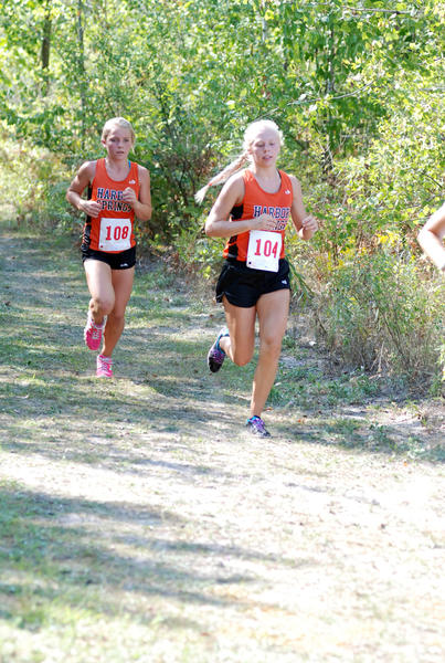 Harbor Springs junior Betsy Simons (right) and freshman Jessica Worm work towards the lead group of runners Wednesday at the East Jordan Invitational. Simons finished 10th in 22 minutes, 6.9 seconds, while Worm was 12th, 22:16.4 as the Rams swept the meet.