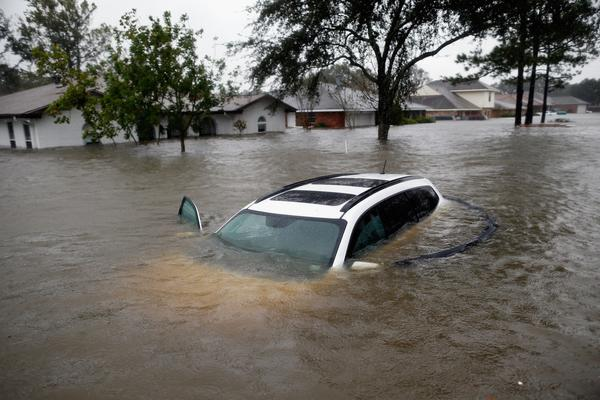 A car sits submerged in the floodwaters of Hurricane Isaac in LaPlace, La.