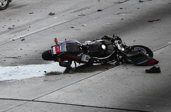 Illinois State Police stay on the scene of a fatal motorcycle accident on the inbound Dan Ryan Expressway in Chicago.