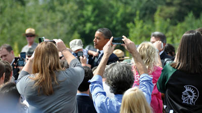 People strain to take a photo of President Barack Obama during the 10th anniversary service at the Flight 93 National Memorial on Sept. 11. The National Park Service has released a schedule of events at the site for the 11th anniversary.