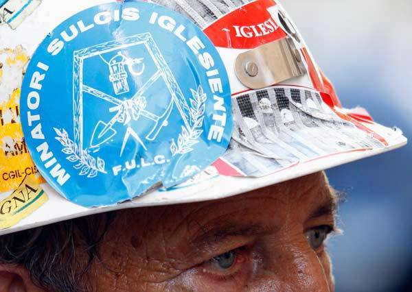 A worker from Aluminium group Alcoa attends a protest in front of the Ministry of Employment building in Rome.