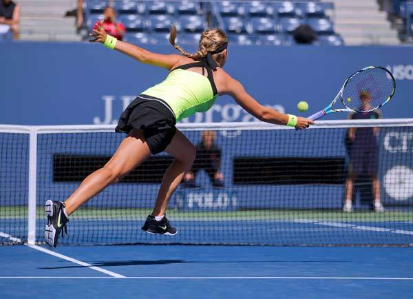 Victoria Azarenka (BLR) returns a shot against Kirsten Flipkens (BEL) on day three of the 2012 US Open at Billie Jean King National Tennis Center.