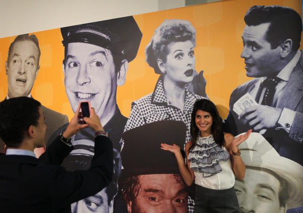 Jessica Perez poses in front of an image of Lucille Ball and Desi Arnaz at the grand opening of the Museum of Broadcast Communications on June 13, 2012.