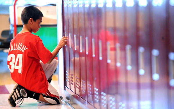 Austin Brockel, 11, a new 6th-grader, tries out his locker for the first time. At Orefield Middle School students are gearing up for a big change - a transition to 6th grade and middle school.