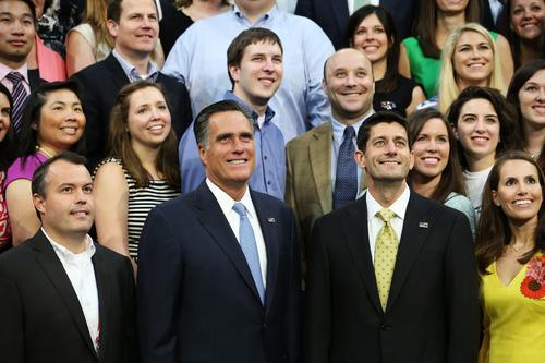 Republican presidential candidate Mitt Romney and vice presidential candidate Paul Ryan pose with campaign staffers during the final day of the Republican National Convention in Tampa, Fla.