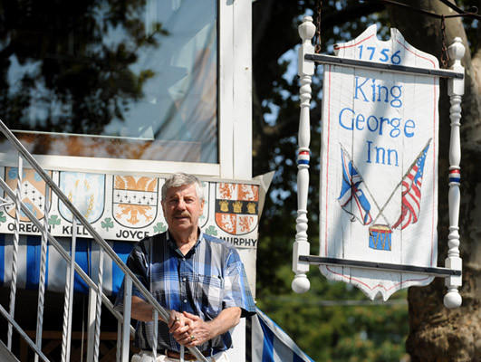 King George Inn owner Cliff McDermott poses at his historic King George Inn. He recently closed the long-time eatery.